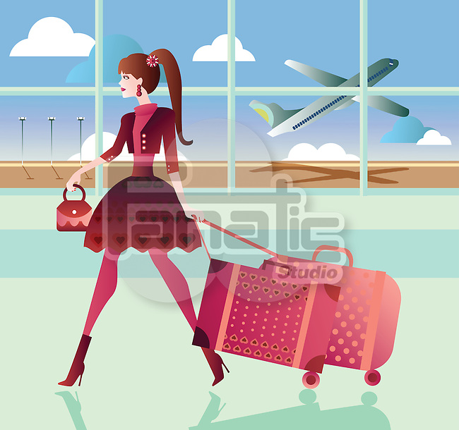 Woman pulling her luggage at an airport