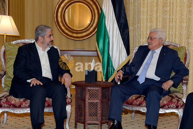 Palestinian president Mahmud Abbas meeting with the head of the political bureau of Hamas, Khaled Meshaal, in Doha, on July 20, 2014. Abbas is in Qatar to discuss a ceasefire with Hamas' leader Khaled Meshaal for the war raging in Gaza , in which over 500 people have been killed during an Israeli military offensive. Photo by Thaer Ganaim