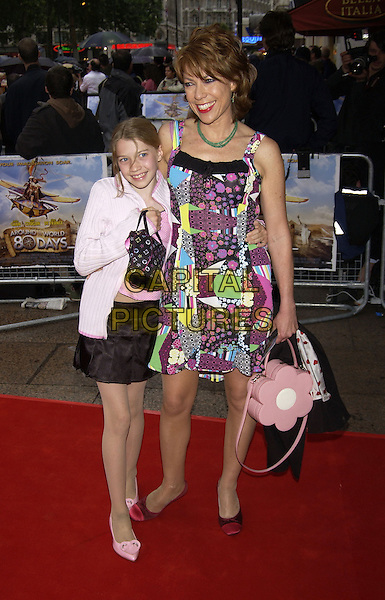 "KATHY LETTE.arrivals at premiere of.""Around the World in 80 Days"".Leicester Square, London.22 June 2004.CAP/PL.full length, child, flowers bag, floral print multi coloured dress, hug, embrace.www.capitalpictures.com.sales@capitalpictures.com.©Capital Pictures"
