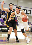 SIOUX FALLS, SD - DECEMBER 6:  Laura Johnson #32 from the University of Sioux Falls drives against Millie Niggeling #40 from Wayne State in the first half of their game Friday night at the Stewart Center. (Photo by Dave Eggen/Inertia)