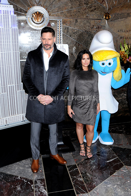www.acepixs.com<br /> March 20, 2017  New York City<br /> <br /> Joe Manganiello and Demi Lovato attending a lighting ceremony at The Empire State Building to celebrate the 'Small Smurfs Big Goals' campaign and the International Day Of Happiness on March 20, 2017 in New York City.<br /> <br /> Credit: Kristin Callahan/ACE Pictures<br /> <br /> Tel: 646 769 0430<br /> Email: info@acepixs.com