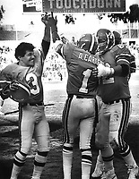 Oakland Invader Anthony Carter #1 is congratulated afer TD grab, #3 Novo Bojovic, (1985 photo/Ron Riesterer)
