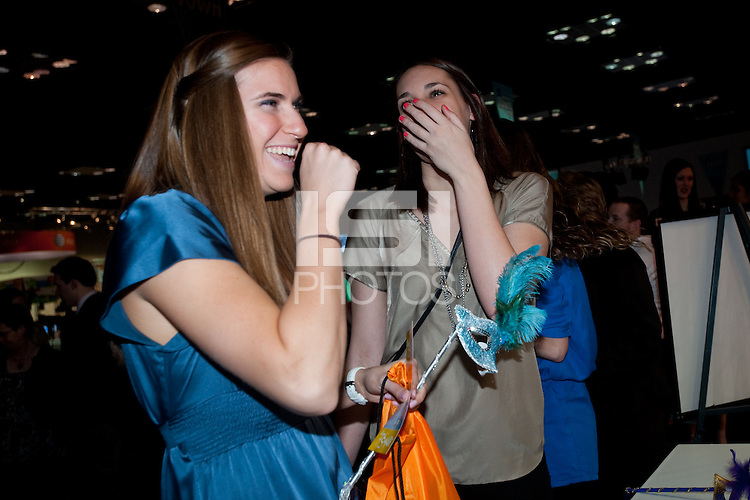 INDIANAPOLIS, IN - APRIL 1, 2011: Jeanette Pohlen and Ashley Ciminio enjoy the festivities at the Cirque du Salute at the Indianapolis Convention Center at Tourney Town during the NCAA Final Four in Indianapolis, IN on April 1, 2011.