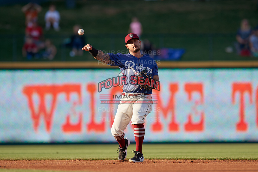 Frisco RoughRiders Christian Lopes (11) throws to first base during a Texas League game against the Springfield Cardinals on May 4, 2019 at Dr Pepper Ballpark in Frisco, Texas.  (Mike Augustin/Four Seam Images)