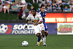 23 April 2009:  Danleigh Borman (11) of the Red Bulls moves the ball past Herculez Gomez (behind) of the Wizards.  The MLS Kansas City Wizards defeated the visiting New York Red Bulls 1-0 at Community America Ballpark in Kansas City, Kansas.