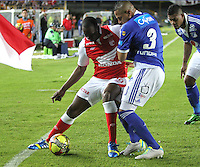 BOGOTA -COLOMBIA- 21 -09-2013.Juan Caicedo (Izq) de Independiente Santa Fe disputa el balón con Abderson Zapata (Der)de Los Millonarios.  Acción de Juego Correspondiente al partido  de Los  Millonarios contra el  Independiente  Santa Fe , partido correspondiente a la decima fecha de La Liga Postobon segundo semestre jugado en el estadio Nemesio Camacho El Campin / Anderson Zapata(R) of The Millionaires disputes the ball against Juan Caicedo  (L) of the Independent Santa Fe, party corresponding to the ten date of The League Postobon the second semester played in the stadium Nemesio Camacho The Campin  .Photo: VizzorImage / Felipe Caicedo / Staff
