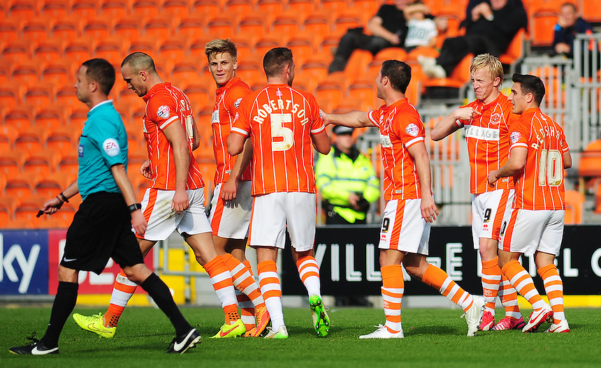 Blackpool's Mark Cullen (2nd right) celebrates scoring his sides first goal and makes it clear who got the last touch<br /> <br /> Photographer Kevin Barnes/CameraSport<br /> <br /> Football - The Football League Sky Bet League One - Blackpool v Swindon Town - Saturday 3rd October 2015 - Bloomfield Road - Blackpool<br /> <br /> &copy; CameraSport - 43 Linden Ave. Countesthorpe. Leicester. England. LE8 5PG - Tel: +44 (0) 116 277 4147 - admin@camerasport.com - www.camerasport.com