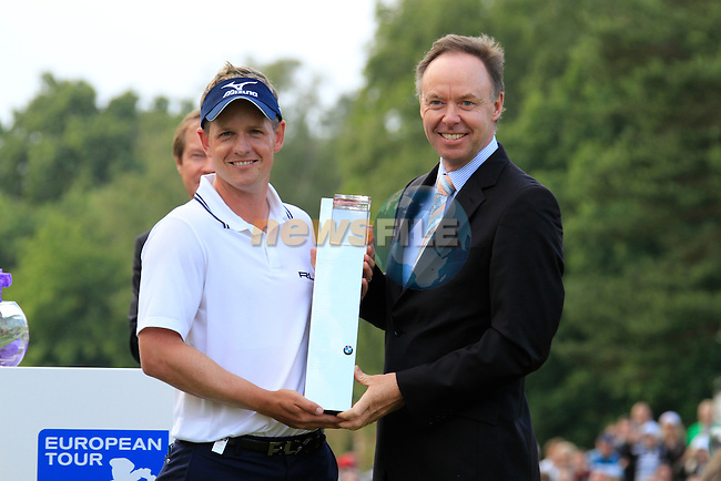 Luke Donald (ENG) is presented with the trophy by Ian Robertson BMW Group after winning the tournament and also becomes World No.1 at the end of the Final Day of the BMW PGA Championship at Wentworth Club, Surrey, England, 29th May 2011. (Photo Eoin Clarke/Golffile 2011)
