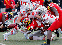Maryland Terrapins running back Anthony McFarland (5) fumbles the ball into the end zone that Maryland Terrapins tight end Chigoziem Okonkwo (17) recovers for a touchdown after being tackled by Ohio State Buckeyes linebacker Pete Werner (20) and Ohio State Buckeyes safety Brendon White (25) during the 4th quarter of their game at Capital One Field at Maryland Stadium in College Park, Maryland on November 17, 2018. [Kyle Robertson/Dispatch]