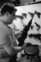 "Switzerland. Canton Obwald. Lungern. Brünig Indoor. A young man is checking an automatic or semi-automatic assault rifle SG 550 in Brünig Indoor. The SG 550 is an assault rifle manufactured by Swiss Arms AG (formerly Schweizerische Industrie Gesellschaft) of Neuhausen, Switzerland. ""SG"" is an abbreviation for Sturmgewehr, or ""assault rifle"". The rifle is based on the earlier 5.56mm SG 540 and is also known as the Fass 90 or Stgw 90. An assault rifle is a selective-fire rifle that uses an intermediate cartridge and a detachable magazine. All weapons and handguns are for sale. 16.06.2016 © 2016 Didier Ruef"