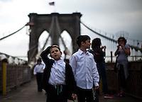Children walk through the Brooklyn Bridge while it remains under maintenance one day before its 130th anniversary in New York,  May 23, 2013, Photo by Eduardo Munoz Alvarez / VIEWpress.