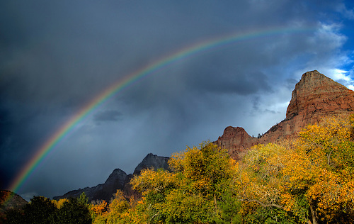 An autumn shower produces a rainbow in Zion Canyon at Zion National Park, Utah