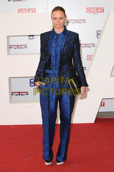 Stella McCartney.The UK Creative Industries Reception supported by The Founders Forum, at the Royal Academy of Arts, London, as part of HM Government's GREAT campaign alongside the very best of the UK Creative Industries from the fields of music, film, art and entertainment..30th July 2012 .full length blazer jumpsuit black blue print clutch bag.CAP/BEL.©Tom Belcher/Capital Pictures.