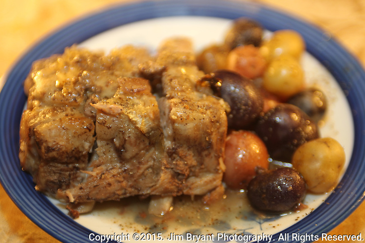 Slow Cook, Roasted  Baby Back Pork Ribs with steamed Yellow, Purple and Red Potatoes. ©2015.  Jim Bryant Photo. All Rights Reserved.