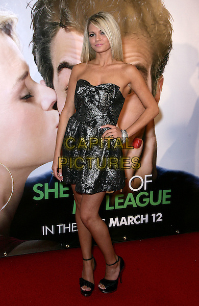 """ANGEL PORRINO .At The Las Vegas Premiere of """"She's Out of My League"""" at the Planet Hollywood Resort Hotel and Casino, Las Vegas, Nevada, USA, 10th March 2010..full length dress hand on hip strapless silver metallic grey smiling bracelet ankle strap black sandals .CAP/ADM/MJT.© MJT/AdMedia/Capital Pictures."""