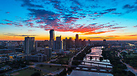 Aerial image of the Austin Skyline and Lady Bird Lake during a beautiful red sunrise.