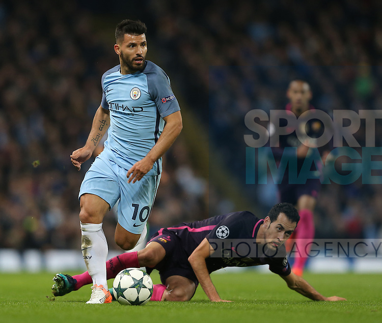 Sergio Aguero of Manchester City and Sergio Busquets of Barcelona during the Champions League Group C match at the Etihad Stadium, Manchester. Picture date: November 1st, 2016. Pic Simon Bellis/Sportimage