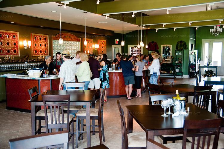 Visitors crowd around the tasting bar at Narmada Winery.