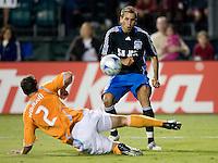 13 September 2008: Darren Huckerby of the Earthquakes kicks the ball over Eddie Robinson of the Dynamo during the game at Buck Shaw Stadium in Santa Clara, California.   San Jose Earthquakes tied Houston Dynamo, 1-1.