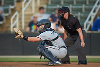 Rome Braves catcher Shea Langeliers (4) sets a target as home plate umpire Jennifer Pawol looks on during the game against the Kannapolis Intimidators at Kannapolis Intimidators Stadium on July 2, 2019 in Kannapolis, North Carolina.  The Intimidators walked-off the Braves 5-4. (Brian Westerholt/Four Seam Images)