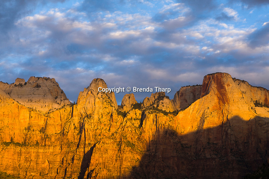 Sunrise lights the Towers of the Virgin in Zion National Park, Utah.