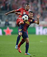 FUSSBALL  CHAMPIONS LEAGUE  HALBFINALE  HINSPIEL  2012/2013      FC Bayern Muenchen - FC Barcelona      23.04.2013 Jerome Boateng (hinten, FC Bayern Muenchen) gegen Pedro Rodriguez (vorn, Barca)