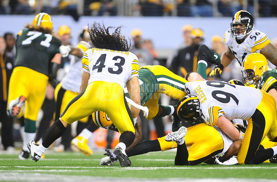 Feb 6, 2011; Arlington, TX, USA; Pittsburgh Steelers safety Troy Polamalu (43) makes a tackle as his hair flies up during Super Bowl XLV against the Green Bay Packers at Cowboys Stadium.  Mandatory Credit: Mark J. Rebilas-