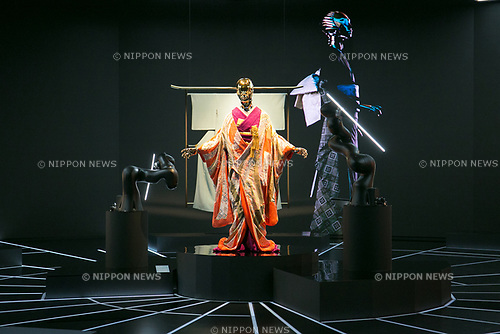 A humanoid robot dressed in traditional kimono performs during the opening ceremony for the KIMONO ROBOTO exhibition at Omotesando Hills on November 30, 2017, Tokyo, Japan. The exhibition features 13 kimonos created by experts using traditional methods and a humanoid robot dressed in traditional kimono performing in the middle of the hall. The exhibition runs til December 10. (Photo by Rodrigo Reyes Marin/AFLO)