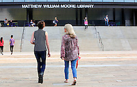 NWA Democrat-Gazette/DAVID GOTTSCHALK   Grace Gardner (left), a freshman at Fayetteville High School, walks across the courtyard with her mother Michele Bond before classes begin on the first day of school at the high school Monday, August 17, 2015. Parents of freshman students were invited to escort and attend classes on the first day of school. Classes were shortened and students only attended for a half day.