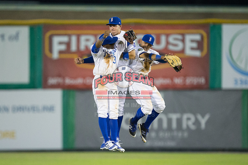 (L-R) Burlington Royals outfielders Jonathan McCray (3), Vance Vizcaino (6), and Cristhian Vasquez (44) celebrate their win over the Bluefield Blue Jays at Burlington Athletic Stadium on June 27, 2016 in Burlington, North Carolina.  The Royals defeated the Blue Jays 9-4.  (Brian Westerholt/Four Seam Images)