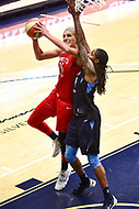 Washington, DC - September 2 2018: Washington Mystics forward Elena Delle Donne (11) makes a strong move to the basket guarded by Atlanta Dream forward Jessica Breland (51) during semifinals game against Atlanta Dream. Mystics even the series and force a deciding game 5 in Atlanta with a 97-76 win at the Charles Smith Center at George Washington University in Washington, DC. (Photo by Phil Peters/Media Images International)