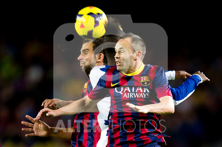 FC Barcelona's Martin Montoya (left), Andres Iniesta (right) and RCD Espanyol's Thievy Bifouma fight for the ball during La Liga 2013-2014 match. November 1, 2013. (ALTERPHOTOS/Alex Caparros)