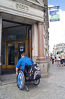 Wheelchair user unable to access the building due to high step and no ramp. This image may only be used to portray the subject in a positive manner..©shoutpictures.com..john@shoutpictures.com