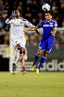 Kansas City Wizard midfielder Stephane Auvray beats LA Galaxy forward Edson Buddle to the ball. The Kansas City Wizards beat the LA Galaxy 2-0 at Home Depot Center stadium in Carson, California on Saturday August 28, 2010.