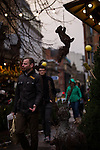 © Joel Goodman - 07973 332324 . 21 November 2013 . Manchester , UK . Squirrel hanging from a stall in Albert Square . Candid photos of the Christmas Markets in Manchester City Centre . Photo credit : Joel Goodman