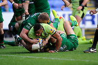 Luther Burrell of Northampton Saints is stopped short of the line by Kieran Low of London Irishduring the Premiership Rugby match between London Irish and Northampton Saints at the Madejski Stadium on Saturday 4th October 2014 (Photo by Rob Munro)