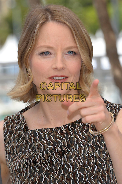 JODIE FOSTER.'The Beaver' photocall at the Palais des Festival, 64th International Cannes Film Festival, France.17th May 2011.headshot portrait brown beige print hand finger pointing  .CAP/PL.©Phil Loftus/Capital Pictures.