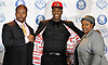 Lawrence Woodmere Academy's Aidan Igiehon, a 6'10 basketball standout from Ireland, poses for pictures with his uncle, Solomon Edore, and aunt, Zenobia Edore, after selecting the University of Louisville as his college choice during a news conference at Lawrence Woodmere Academy on Friday, Oct. 19, 2018.