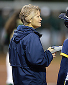 Michigan Wolverines Softball coach Bonnie Tholl during a game against the University of South Florida Bulls on February 8, 2014 at the USF Softball Stadium in Tampa, Florida.  Michigan defeated USF 3-2.  (Copyright Mike Janes Photography)