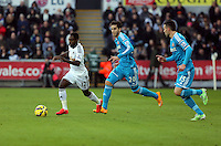 SWANSEA, WALES - FEBRUARY 07: Nathan Dyer of Swansea (L) chased by two Sunderland players during the Premier League match between Swansea City and Sunderland AFC at Liberty Stadium on February 7, 2015 in Swansea, Wales.