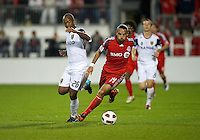 28 September 2010: Real Salt Lake midfielder Collen Warner #26  and Toronto FC forward Dwayne De Rosario #14 in action during a CONCACAF Champions League game between Real Salt Lake and Toronto FC at BMO Field in Toronto...
