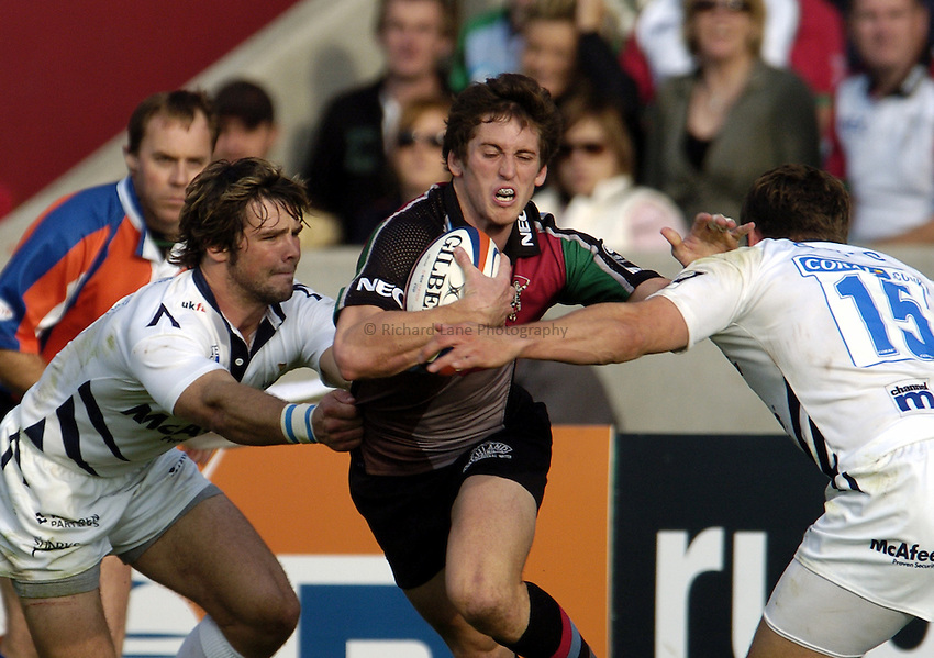 Photo: Olly Greenwood..NEC Harlequins v Sale Sharks. EDF Anglo-Welsh Cup. 07/10/2006. Harlequins Tom Williams is tackled by Sale's Ben Foden and Mark Cueto.