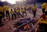 Military trained as fire fighters rest after a long day of smoldering flames at the Clear Creek wildfire in Idah. ..More than a billion dollars is spent annually suppressing fires that burn millions of acres of western land..... Though wildland fires play an integral role in many forest and rangeland ecosystems, decades of efforts directed at extinguishing every fire that burned on public lands have disrupted the natural fire regimes that once existed. ....Moreover, as more and more communities develop and grow in areas that are adjacent to fire-prone lands in what is known as the wildland/urban interface, wildland fires pose increasing threats to people and their property...