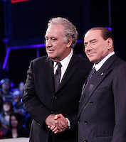 "L'ex presidente del Consiglio Silvio Berlusconi stringe la mano al giornalista e conduttore televisivo Michele Santoro, a sinistra, poco prima di prendere parte alla trasmissione televisiva ""Servizio Pubblico"" negli studi La7 di Cinecitta' a Roma, 10 gennaio 2013..Italian former Premier Silvio Berlusconi shakes hands with journalist and show host Michele Santoro, left, prior to take part in the talk show ""Servizio Pubblico"" (""Public Service"") hosted by La7 tv at the Cinecitta' studio in Rome, 10 January 2013..UPDATE IMAGES PRESS/Riccardo De Luca"