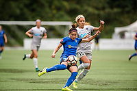 Seattle, WA - Sunday, August 13, 2017: Nahomi Kawasumi and Jaelene Hinkle during a regular season National Women's Soccer League (NWSL) match between the Seattle Reign FC and the North Carolina Courage at Memorial Stadium.