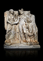 "Roman Sebasteion relief sculpture of emperor Claudius and Agrippina, Aphrodisias Museum, Aphrodisias, Turkey.   Against a black background.<br /> <br /> Claudius in heroic nudity and military cloak shakes hands with his wife Agrippina and is crowned by the Roman people or the Senate wearing a toga. The subject is imperial concord with the traditional Roman state. Agrippina holds ears of wheat: like Demeter goddess of fertility. The emperor is crowned with an oak wreath, the Corona civica or ""citizen crow"", awarded to Roman leaders for saving citizens lives: the emperor id therefore represented as saviour of the people."