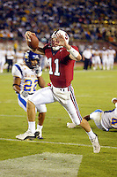 Kyle Matter scrambles for a touchdown during Stanford's 63-26 win over San Jose State on September 14, 2002 at Stanford Stadium.<br />