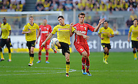 Fussball Bundesliga Saison 2011/2012 8. Spieltag Borussia Dortmund - FC Augsburg V.l.: Robert LEWANDOWSKI (BVB), Sebastian LANGKAMP (Augsburg).