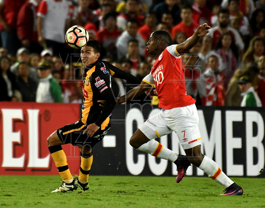BOGOTA - COLOMBIA – 23 – 05 - 2017: Leyvin Balanta (Der.) jugador de Independiente Santa Fe, disputa el balón con Diego Wayar (Izq.) jugador de The Strongest, durante partido entre Independiente Santa Fe de Colombia y The Strongest de Bolivia, de la fase de grupos, grupo 2, fecha 6 por la Copa Conmebol Libertadores Bridgestone 2017, en el estadio Nemesio Camacho El Campin, de la ciudad de Bogota. / Leyvin Balanta (R) player of Independiente Santa Fe, fights for the ball with Diego Wayar (L) player of The Strongest during a match between Independiente Santa Fe of Colombia and The Strongest of Bolivia, of the group stage, group 2 of the date 6th, for the Conmebol Copa Libertadores Bridgestone 2017 at the Nemesio Camacho El Campin in Bogota city. VizzorImage / Luis Ramirez / Staff.