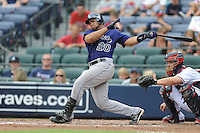 Colorado Rockies catcher Wilin Rosario #20 swings at a pitch during a game against the Atlanta Braves at Turner Field on September 3, 2012 in Atlanta, Georgia. The Braves  defeated the Rockies 6-1. (Tony Farlow/Four Seam Images).